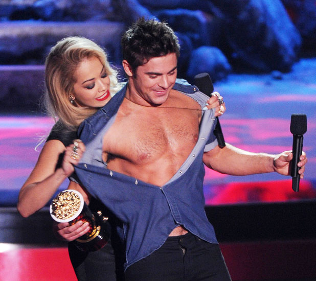 Zac Efron accepts the award for 'Best Shirtless' from Rita Ora 13 Apr 2014