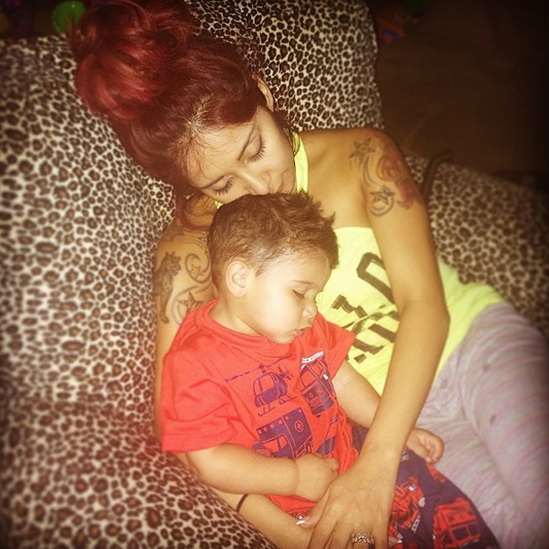 Snooki cuddles up  to son Lorenzo after five days away from home, 14 April 2014