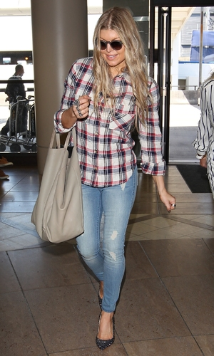 Fergie arrives at Los Angeles International Airport (LAX) wearing jeans and Christian Louboutin heels 04/22/2014 Los Angeles, United States