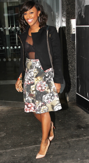 Alexandra Burke was spotted in Soho attending business meetings wearing a revealing sheer top and floral skirt 04/22/2014 London, United Kingdom