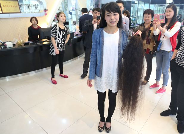 Nursery teacher cuts hair for charity