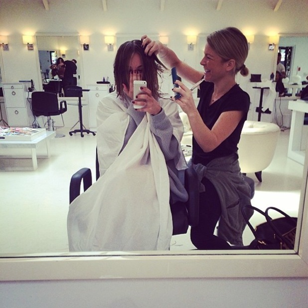 Kaley Cuoco-Sweeting Instagrams a picture at a hair salon while having her hair cut - 23 April 2014