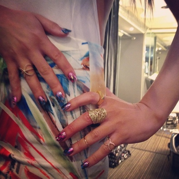 Lea Michele shows off her feather foil manicure by Jenna Hipp while filming her new music video for 'On My Way' - 20 April 2014