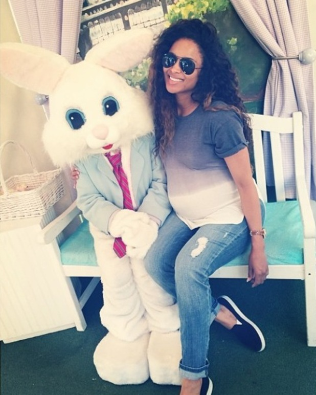 Pregnant Ciara poses with Easter bunny (21 April).
