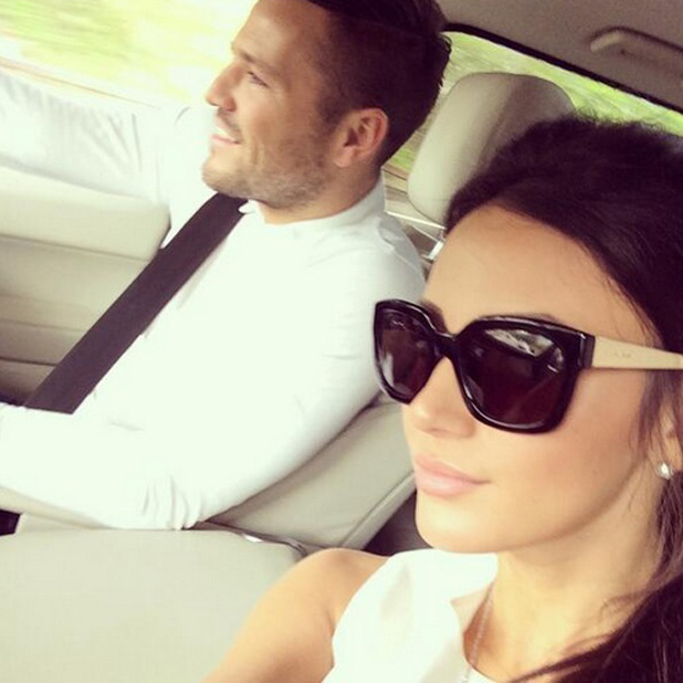 Michelle Keegan and Mark Wright look glamorous in matching white while in a car together, 24 April 2014