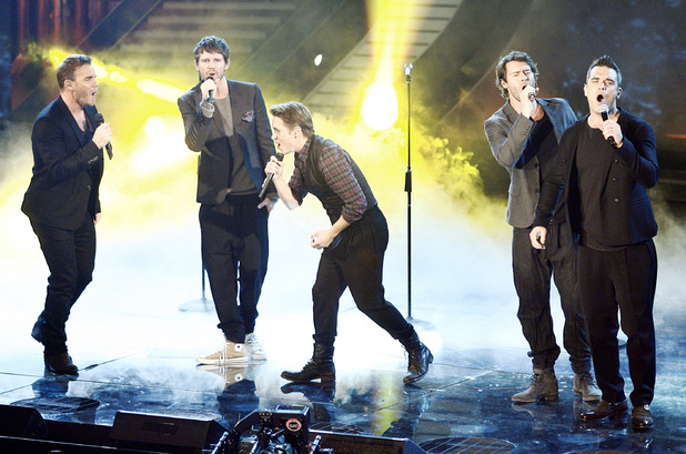 Gary Barlow, Jason Orange, Mark Owen, Howard Donald and Robbie Williams of Take That performing during the final of Italian X Factor. Milan, Italy - 23.11.10