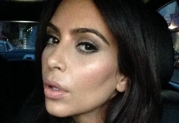 Kim Kardashian shows off 'flirty lashes' on Friday night out, 2 May 2014