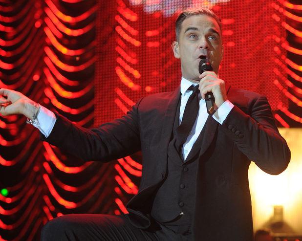 Robbie Williams performing at the Key 103 Jingle Ball held at Phones 4 U Arena Manchester. 12/12/2013.