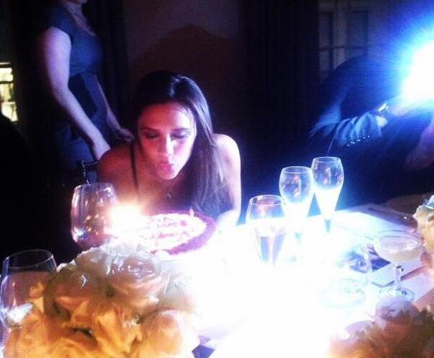 Victoria Beckham blows out candles on birthday cake. Posted 28 April 2014.