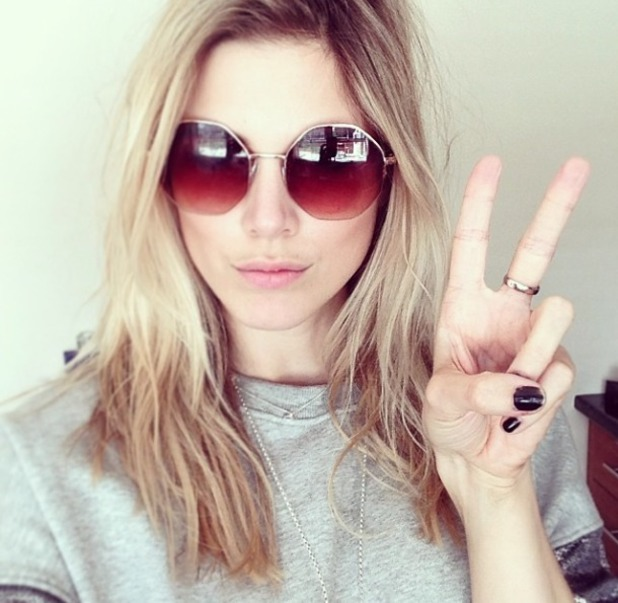 Ashley James reveals her chipped black nails while posing in Claire's sunglasses, 18 April 2014