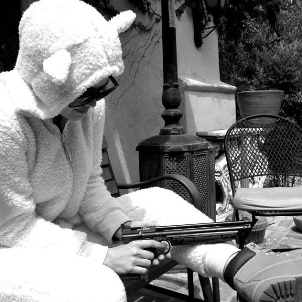 Khloe Kardashian dresses as a sheep and brandishes a gun - 28 April 2014
