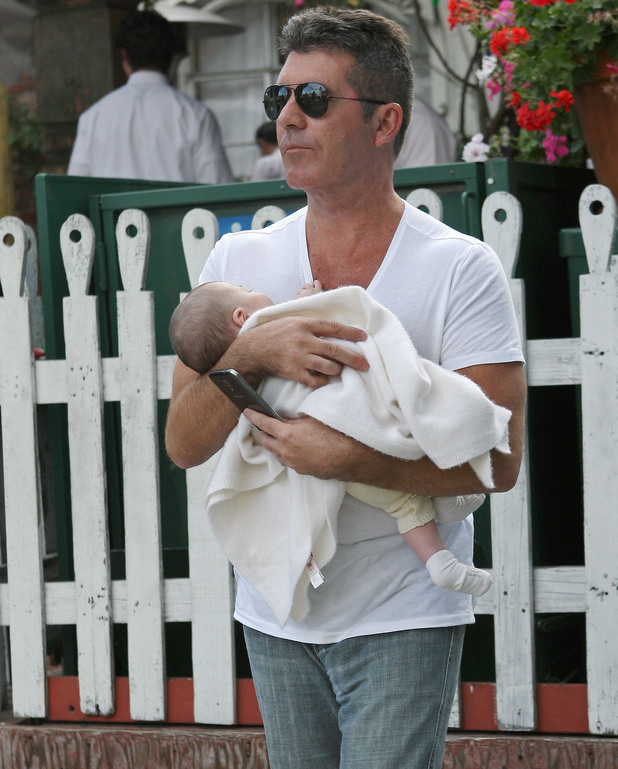 Simon Cowell leaves the Ivy restaurant in West Hollywood, carrying his baby son, Eric in his arms to his waiting Rolls Royce - 27 April 2014