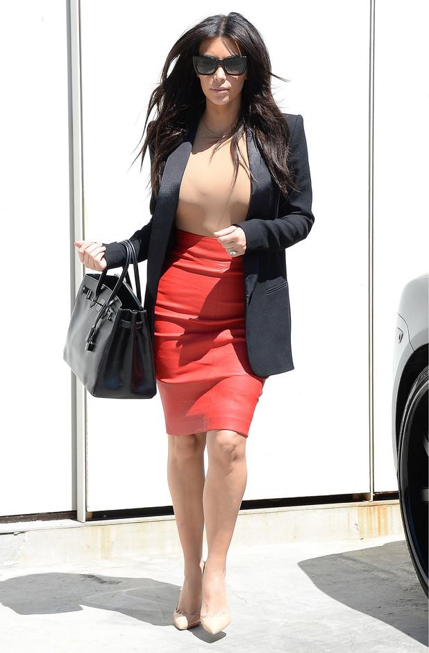 Kim Kardashian rocks red skirt in Los Angeles - 02 May 2014