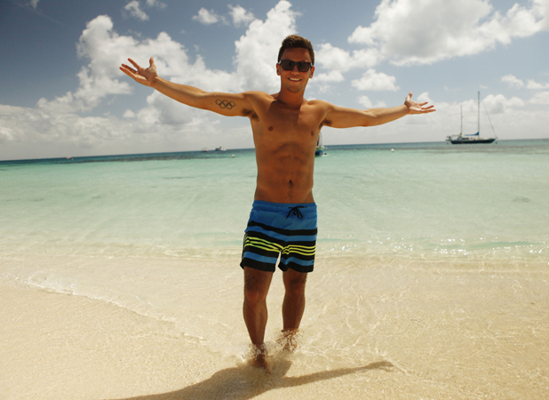 Tom Daley Goes Global: episode four, Tom Daley and Sophie Lee visit Australia. Tom poses on a Cairns beach Airs 1 May 2014