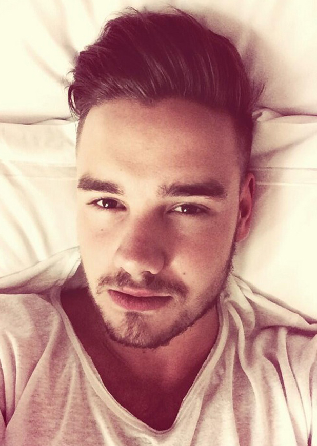 Liam Payne takes a selfie while lying in bed after opening night of Where We Are World Tour in Bogota, Colombia, 26 April 2014