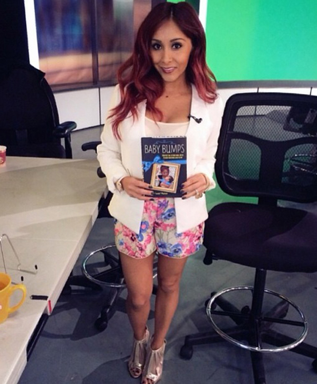 A pregnant Snooki promotes her Baby Bumps book in New York. 1 May 2014