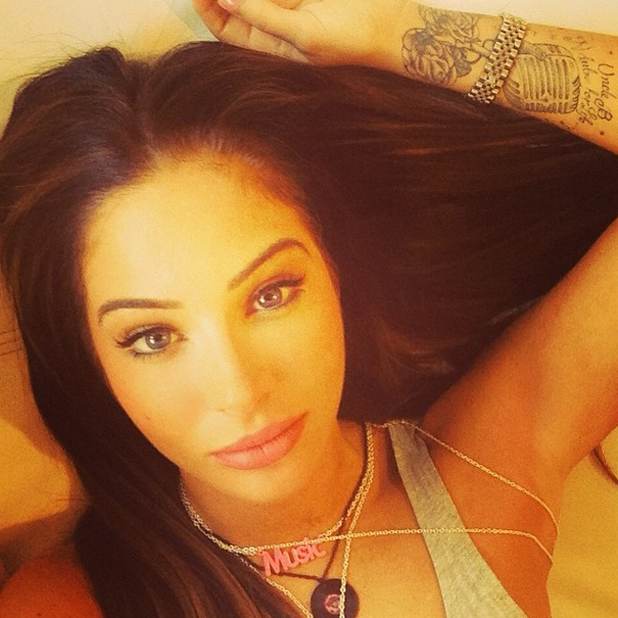 Tulisa poses for sultry selfie, April 2014