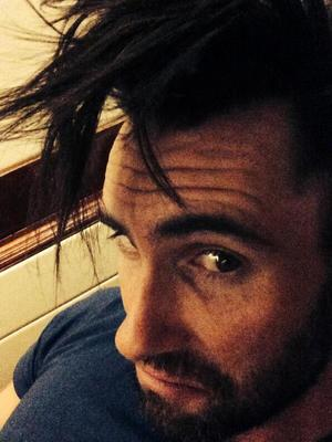 Adam Levine shows off growing hair in Twitter photo (2 May).