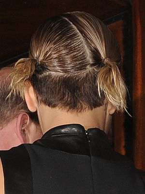 Rita Ora arriving back at a hotel with a strange hairstyle, 8 May 2014