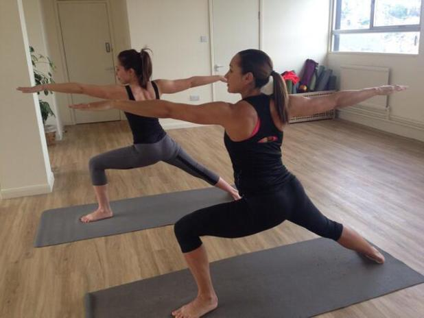 Jessica Ennis-Hill shows off her growing baby bump while doing yoga - 9 May 2014