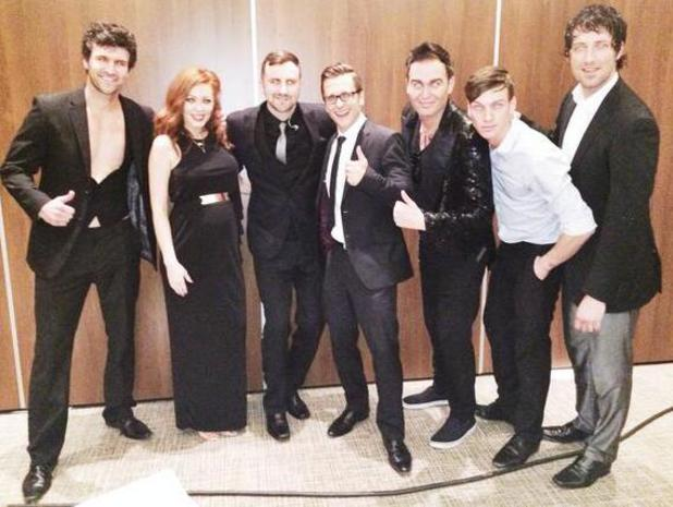 Natasha Hamilton and Ritchie Neville pose at charity gala with Take That tribute band (3 May).