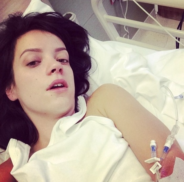Lily Allen takes selfie from hospital bed after falling ill (8 May).