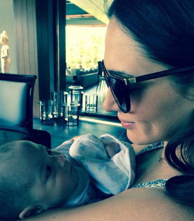 Simon Cowell shares new pictures of baby Eric after flying into the UK - 6 May 2014