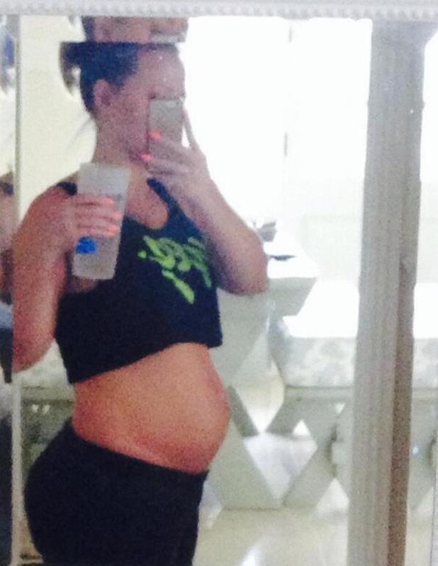 Pregnant Kimberley Walsh shows off baby bump (5 May).