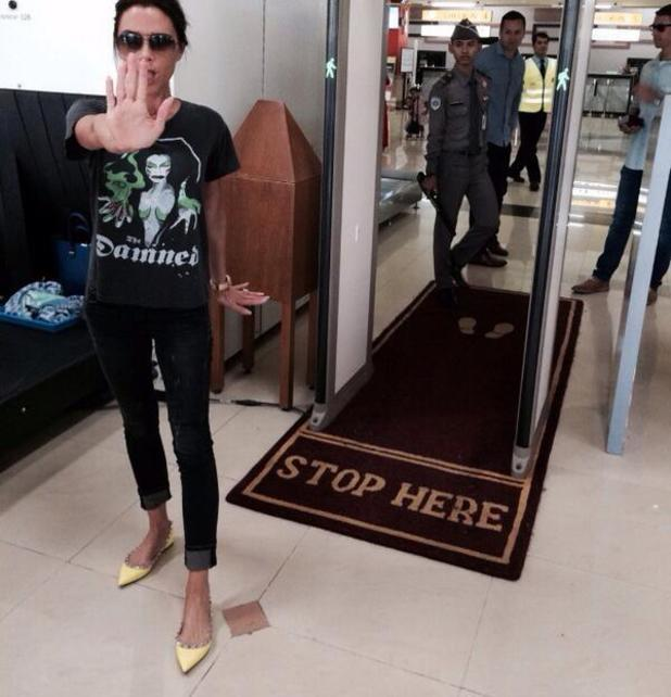 Victoria Beckham makes Spice Girls reference as she arrives at Singapore. (14 May).