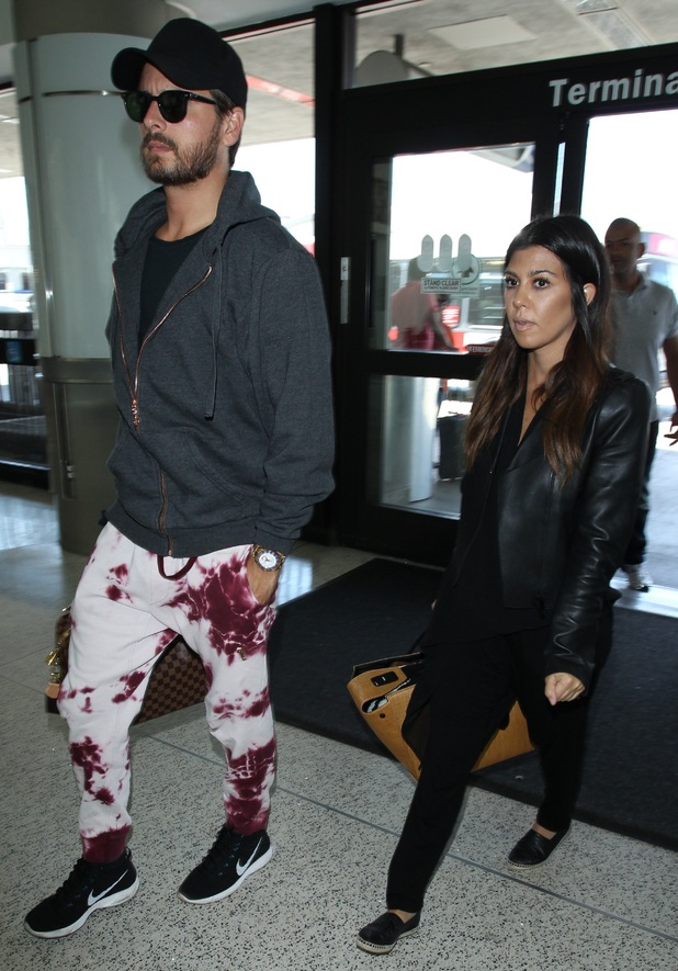 Kourtney Kardashian and Scott Disick arrives at Los Angeles International Airport - America - 10 May 2014