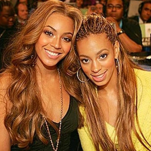 Beyonce uploads throwback picture of herself and sister Solange following claims Solange attacked Jay Z in a lift at the Met Ball, 14 May 2014