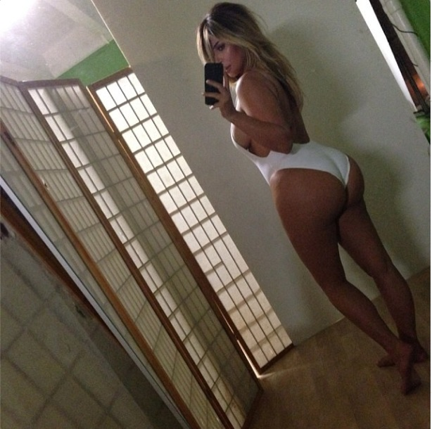 Kim Kardashian shows off bottom in famous belfie (17 October 2013).