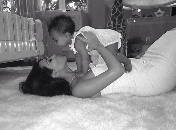Kim Kardashian cuddles into North West on her first Mother's Day, 11 May 2014