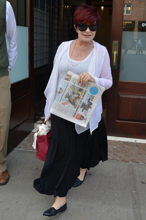 Sharon Osbourne leaving her hotel carrying a USA Today newspaper, 12 May 2014