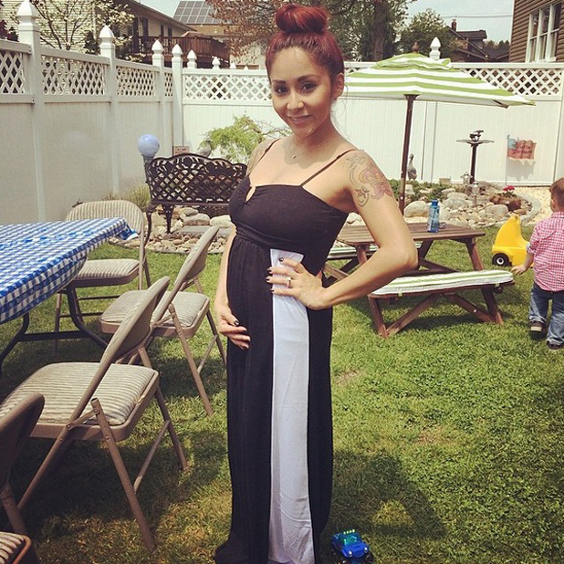Snooki tells fans she's starting to fill out her clothes as baby bump grows, 10 May 2014