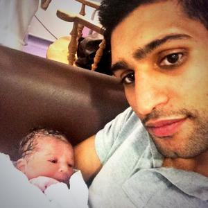 Amir Khan and wife Faryal welcome a baby daughter called Lamysa, 23 May 2014