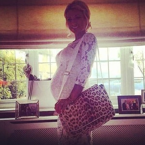 Billie Faiers shows off Roberto Cavalli baby bag ahead of birth - 22 May 2014