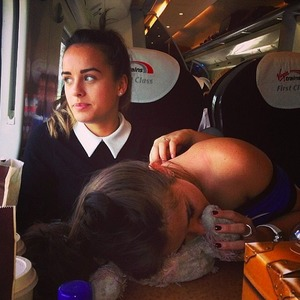 Hungover Brooke Vincent gets an affectionate stroke from Corrie co-star Georgia May Foote on train back to Manchester after British Soap Awards, 25 May 2014