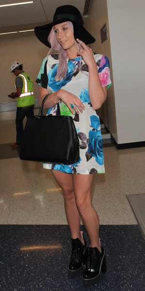 Ke$ha wears a floral dress while stepping out at Los Angeles International Airport in America - 19 May 2014