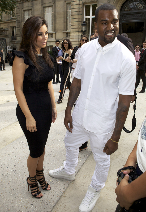 Kim Kardashian and Kanye West arriving at Valentino Haute-Couture Fashion Show in Paris, 7 April 2012