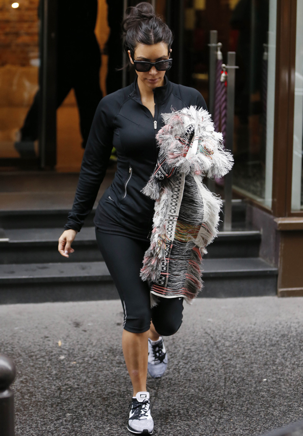 Kim Kardashian keeps her head down as she leaves a Paris gym just two days before wedding, 22 May 2014