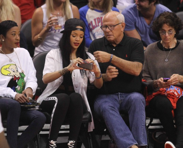 Rihanna accidentally drops Steve Soboroff's phone at a basketball match and it smashes. She then donated $25,000 to the LAPD charity and the phone was put up for auction, May 2014