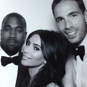 Newlyweds Kim Kardashian and Kanye West pose for a photo with Kim's close friend Simon Huck after wedding in Florence, Italy - 24 May 2014