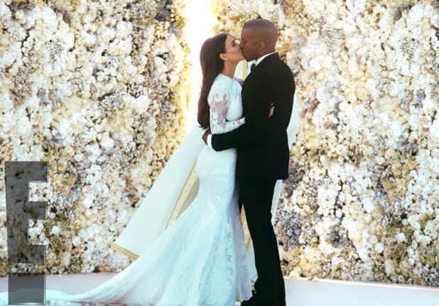 Kim Kardashian and Kanye West kiss in first official wedding picture, 27 May 2014