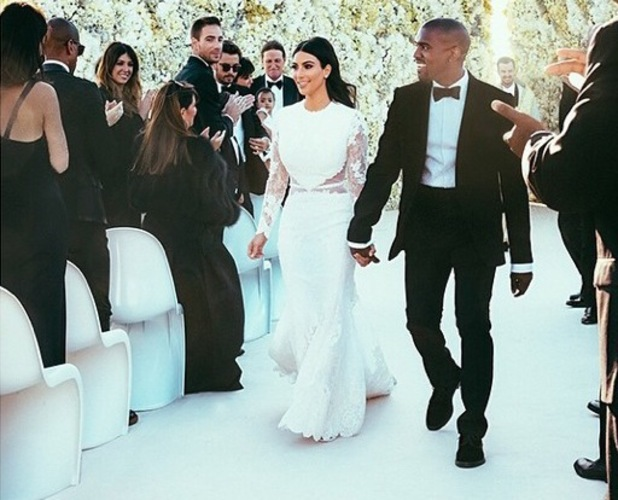 Kim Kardashian and Kanye West walking down the aisle on their wedding day on 24 May 2014