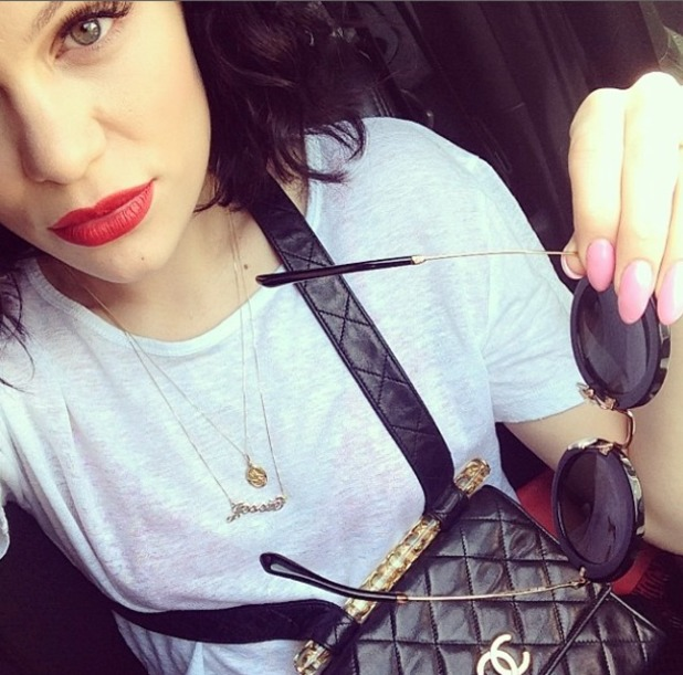 Jessie J shows off pastel pink nails and red lips while in New York City, 7 May 2014