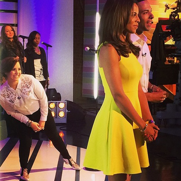 Demi Lovato photobombs Rochelle and Marvin Humes on This Morning, 30 May 2014