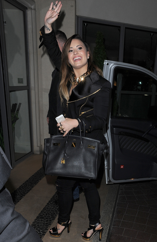 Demi Lovato waves to fans as she returns to London hotel, 28 May 2014