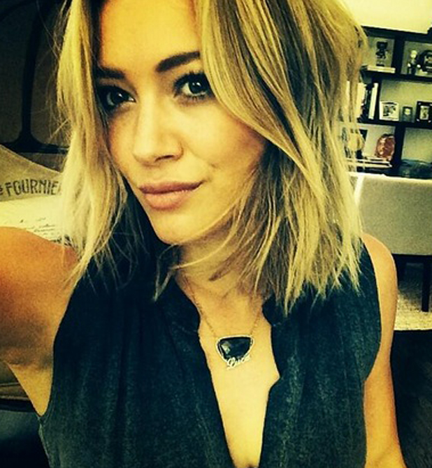 Hilary Duff's stylist Marcus Francis chops her hair into a shoulder length blunt bob, 29 May 2014