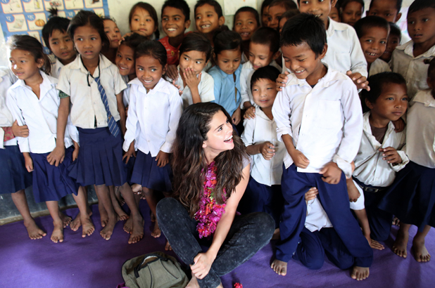 Selena Gomez visits Nepal in her role as UNICEF Ambassador, May 2014.UNICEF Ambassador, Selena Gomez enjoys a sweet moment with a student while the early childhood education class gathers for a group photo at Satbariya Rapti Secondary School.